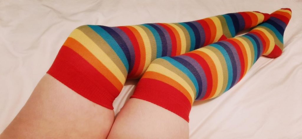 A photo of Amy's late night legs, gorgeous and wearing rainbow striped socks