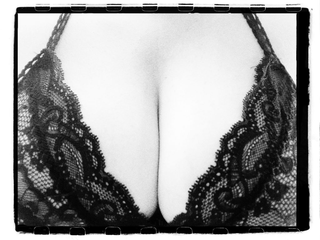 An image that uses contrast for effect - a black and white shot of my cleavage, framed in black lace
